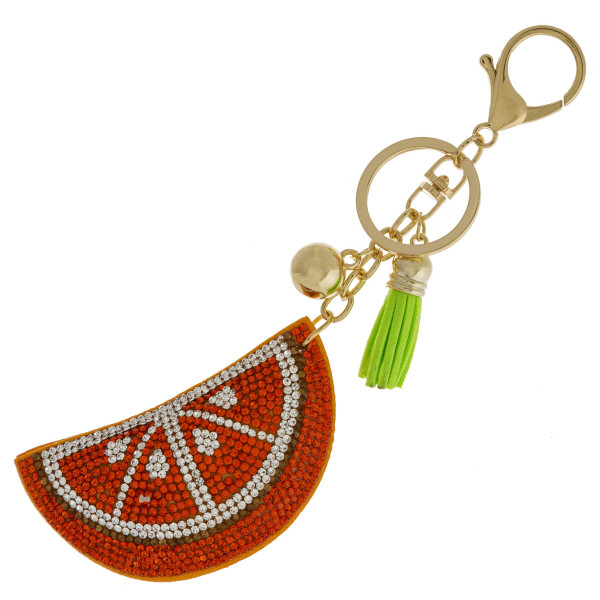 "Orange keychain with faux suede tassel and rhinestone softball. Approximately 2.5"" in diameter."