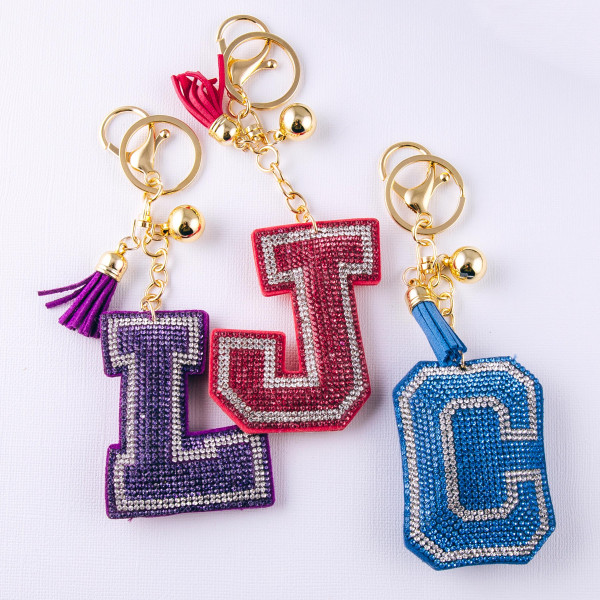 "Light Blue ""C"" initial pillow keychain/bag charm featuring rhinestone details and a tassel accent. Initial approximately 2.5"". Approximately 6"" in length overall."