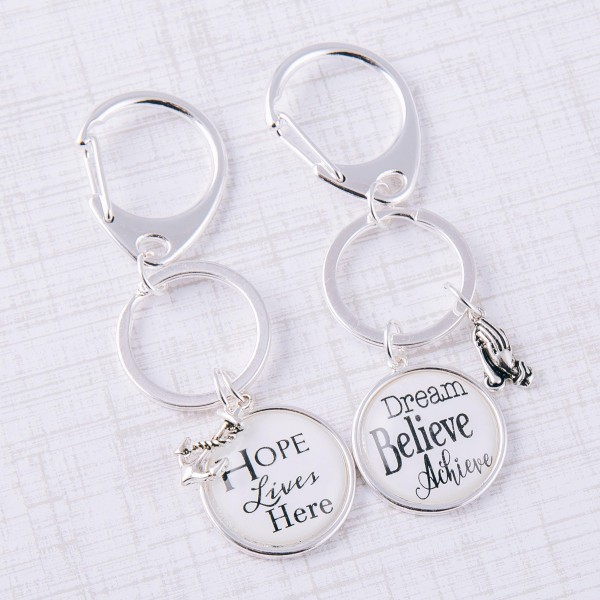 """Dream Believe Achieve"" dome charm keychain holder.  - Approximately 3"" in length and 1"" in diameter"
