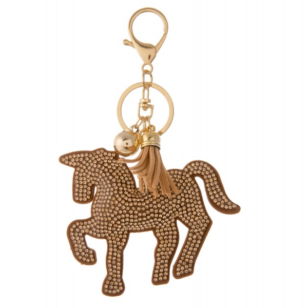 "Stone rhinestone plush horse keychain holder with tassel detail.  - Approximately 5"" in length overall - Horse 3"" W x 2"" T"