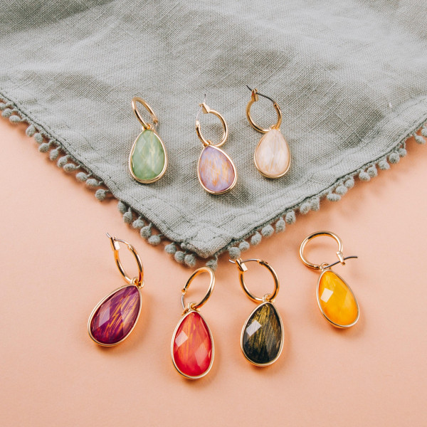 "Tiny hoop earrings featuring a iridescent teardrop accent. Approximately 1"" in length."
