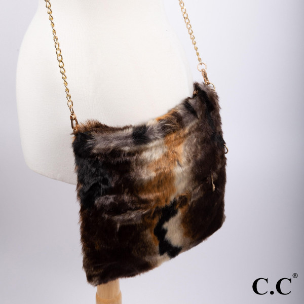 "BG-807: Faux fur fold over C.C cross body purse with gold tone chain. Approximately 12""x 11"""