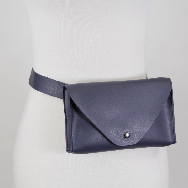 """PU leather fanny pack with magnetic closure. 100% PU leather. 8""""x 5"""""""