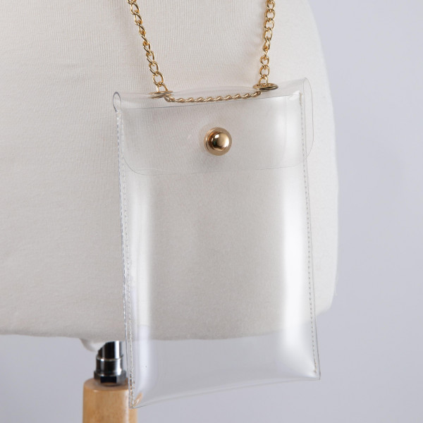 "Gold chained clear cross body purse with snap closure. 7.5"" x 5"""