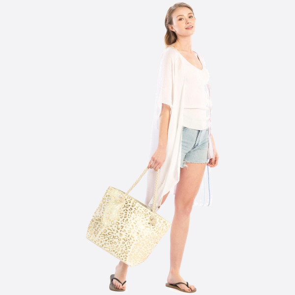 "Large tote bag featuring gold metallic leopard print and rope handles. Approximately 14"" x 19"" in size.   Composition: 90% Paper 10 Polyester."