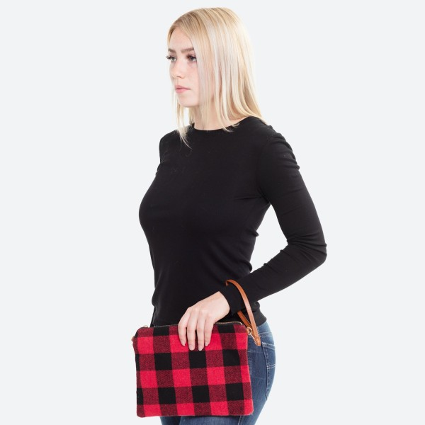 "Buffalo check crossbody/clutch bag featuring an open lined inside with no inside pockets and zipper closure.   - Approximately 10"" W x 8"" H - 100% Polyester"