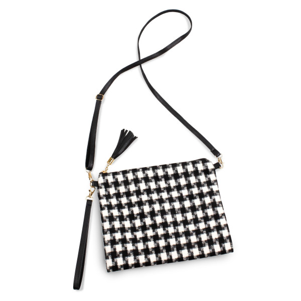 "Houndstooth crossbody/clutch bag featuring a lined inside pocket detail and zipper closure.  - Approximately 11"" W x 8.5"" H  - 100% Polyester"