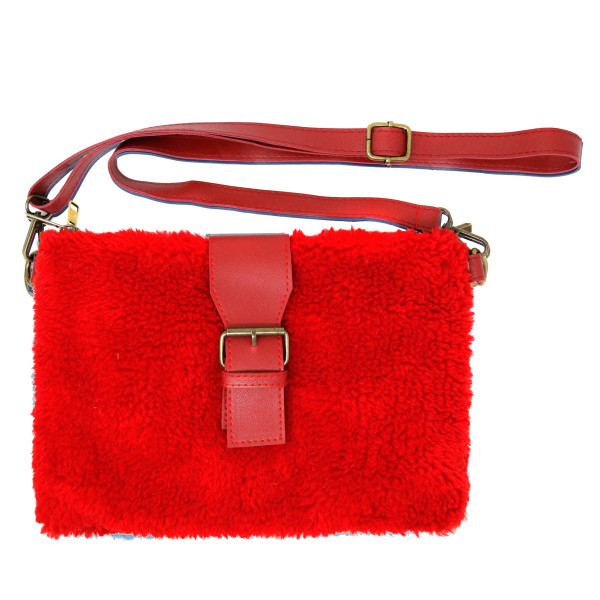 """Faux sherpa fleece crossbody/handbag featuring:  - Two inside separated pockets - One inside zipper pocket - Zipper closure - Faux leather magnetic belt detail  - Approximately 11"""" W x 8"""" T - 90% Polyester, 10% PU"""