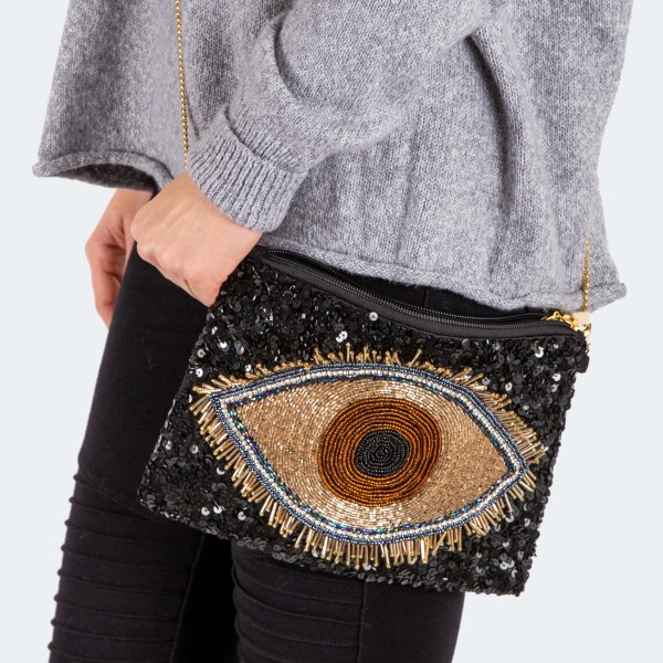 """High quality seed beaded sequins evil eye handbag.  - Zipper closure - One inside open pocket - Inside lining 100% Cotton - Approximately 10.5"""" W x 7"""" T - Strap approximately 52"""" L - Approximately 62"""" L overall - 40% Seed beads, 40% Cotton Canvas, 20% Metal"""