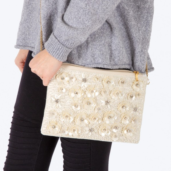 """High quality cream colored pearl beaded handbag with sequins flowers and rhinestone details.  - Zipper closure - One inside open pocket - Crepe Satin inside lining - Approximately 10.5"""" W x 7"""" T - Strap approximately 52"""" L - Approximately 62"""" L overall - 100% Polyester"""