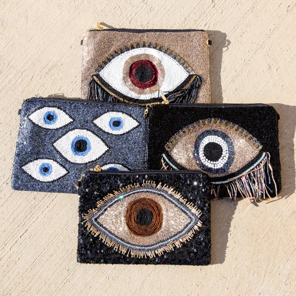"High quality hematite seed beaded evil eye handbag.  - Zipper closure - One inside open pocket - Inside lining 100% Cotton - Approximately 10.5"" W x 7"" T - Strap approximately 52"" L - Approximately 62"" L overall - 40% Seed beads, 40% Cotton Canvas, 20% Metal"