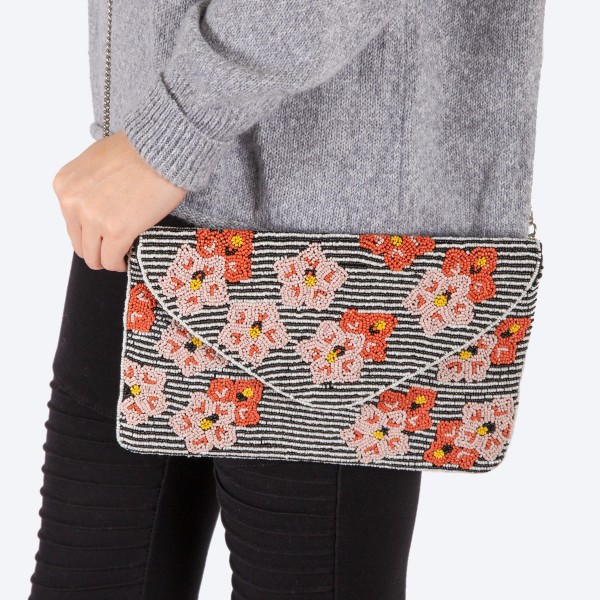 """High quality black and white pinstripe seed beaded flower print handbag.  - Fold over snap button closure - One inside open pocket - Inside lining 100% Cotton - Approximately 10.5"""" W x 6"""" T - Strap approximately 52"""" L - Approximately 62"""" L overall - 40% Seed beads, 40% Cotton Canvas, 20% Metal"""