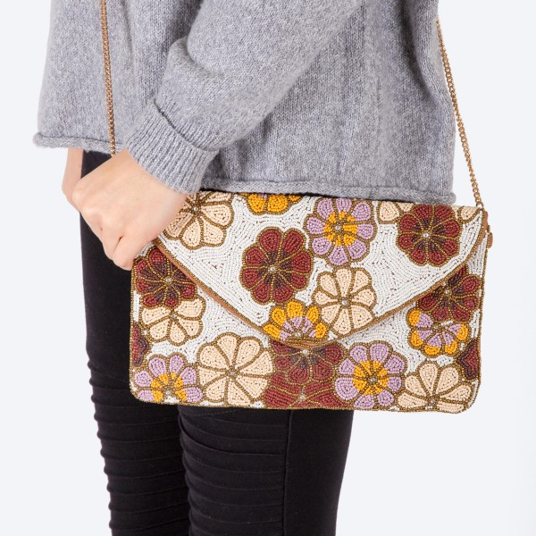 """High quality seed beaded floral print handbag.  - Fold over snap button closure - One inside open pocket - Inside lining 100% Cotton - Approximately 10.5"""" W x 6"""" T - Strap approximately 52"""" L - Approximately 62"""" L overall - 40% Seed beads, 40% Cotton Canvas, 20% Metal"""