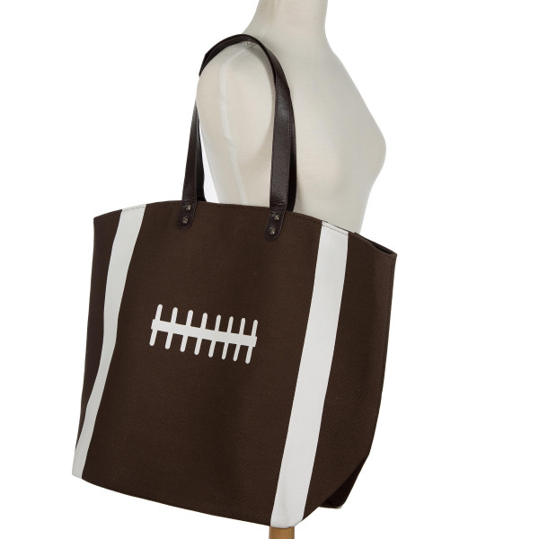 """Football tote bag is perfect for tailgating and monogramming. This bag features a snap closure, lined interior and interior pockets. 16"""" x 19"""" in size with a 10"""" handle drop. 80% cotton and 20% polyester."""