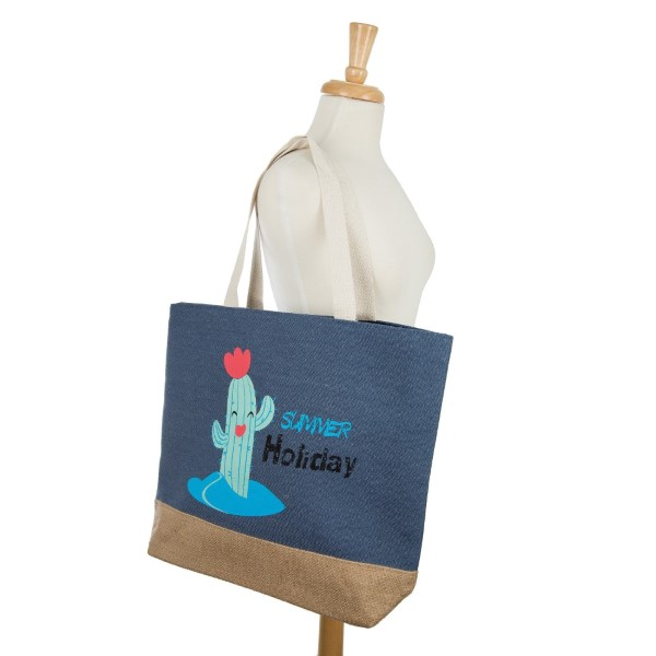 """""""Summer Holiday"""" tote bag with a fully lined interior, magnetic closure, and inside pocket. Measures 20"""" x 15"""" in size with a 10"""" shoulder drop. 55% cotton, 25% polyester, and 20% jute"""