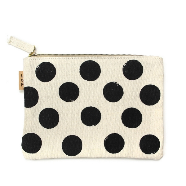 """Canvas zipper pouch with polka dots on the front. 100% cotton. Measures 7"""" x 6"""" in size."""