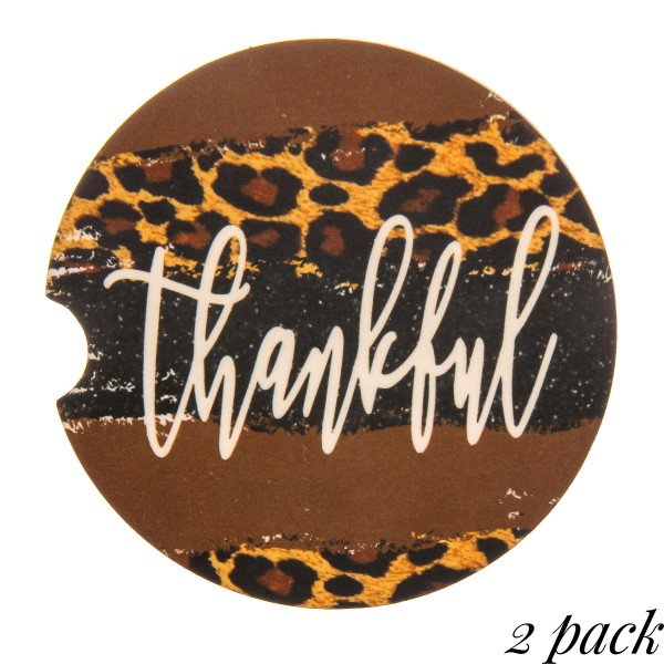 """Leopard print """"Thankful"""" printed car coaster set.  - Pack Breakdown: 2pcs / pack - Approximately 2"""" in diameter - Finger slot for easy removal - Condensation absorbing cork"""