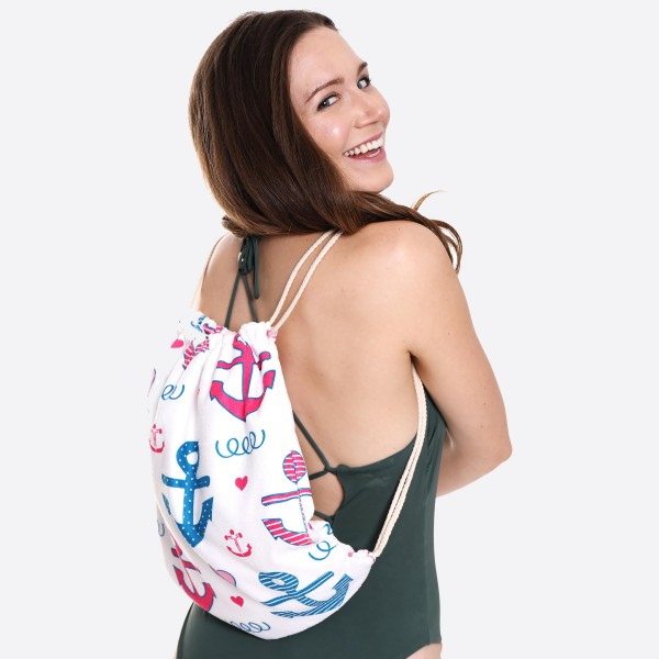 "Pink Anchor Beach Towel Drawstring Bag All in One.  - Unfold your bag to use the soft beach towel - Conveniently folds back into a drawstring bag - Towel approximately 27"" W x 59"" L - 70% Cotton / 30% Polyester"