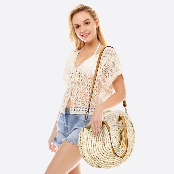 """Round straw woven beach tote bag with tassel.  - Open lined inside - 1 open inside pocket - Zipper closure - Detachable adjustable faux leather handle - Approximately 15"""" in diameter - 90% Paper, 10% PU"""