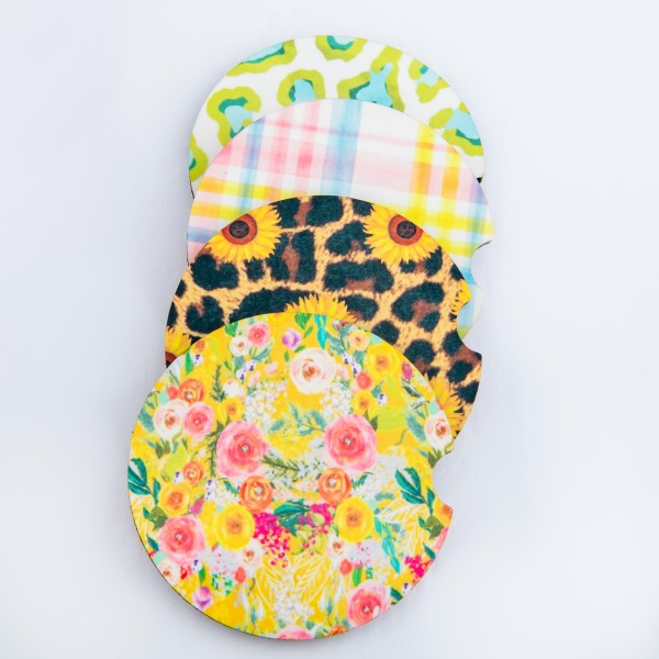 """Yellow Floral printed car coaster set.  - Pack Breakdown: 2pcs/pack - Approximately 2"""" in diameter - Finger slot for easy removal - Condensation absorbing cork"""