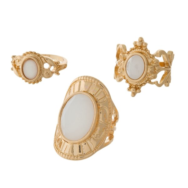Three piece gold tone ring set with white stones. All three rings are approximately a size 7 and are not adjustable.