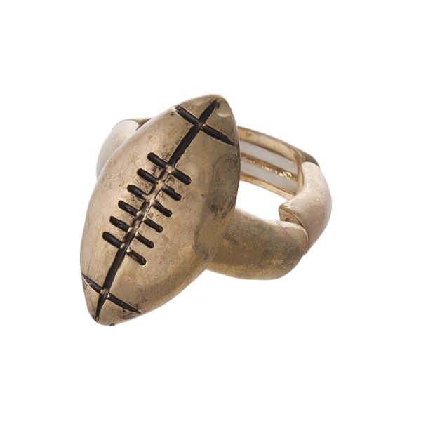 Metal football shaped stretch ring.