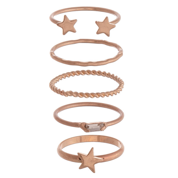 Set of 5 complementary rose gold rings with star accents and textured details. One size fits most.