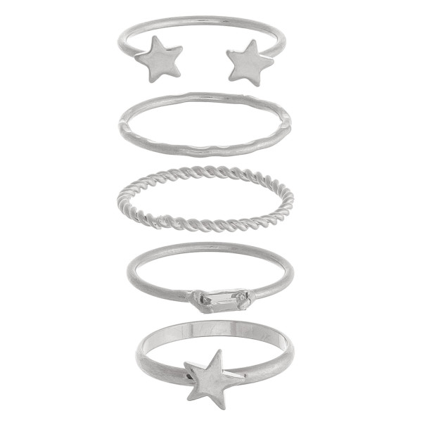 Set of 5 complementary silver rings with star accents and textured details. One size fits most.