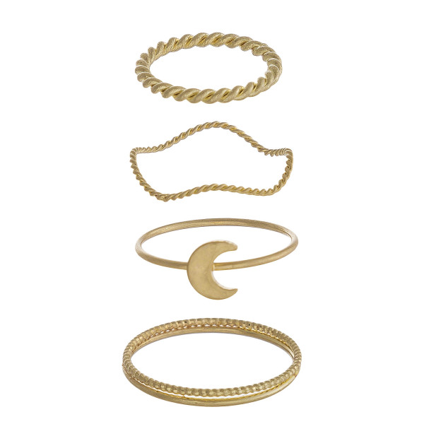 Dainty metal ring set featuring four knuckle rings with twisted texturized details and a moon accent.   - Sizes range from 3-8 ring size