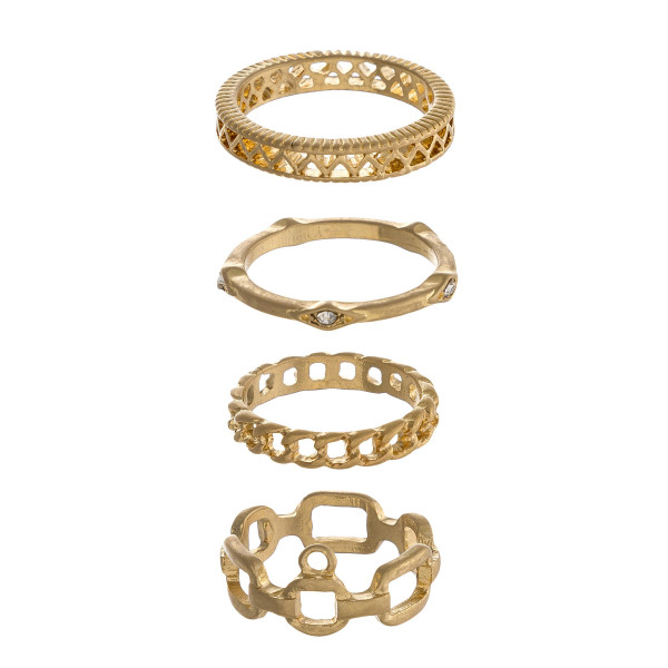 Metal ring set featuring four texturized rings with cubic zirconia details accents and chain link inspired details.  - Fits up to a 8 ring size