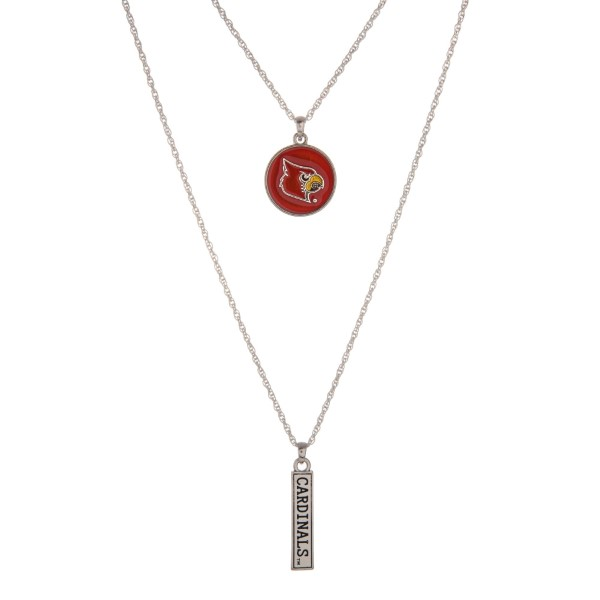 "Officially licensed University of Louisville double layer silver tone necklace with a logo pendant and a ""Cardinals"" stamped bar pendant. Approximately 16"" in length."