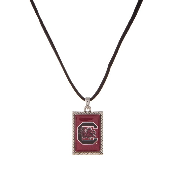 "Officially licensed University of South Carolina necklace with black cord and a square logo pendant. Approximately 16"" in length."