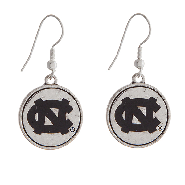 "Officially licensed University of North Carolina silver tone fishhook earrings with a circle logo. Approximately 2"" in length."