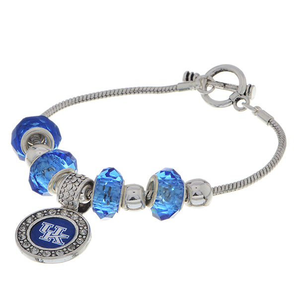 "Officially licensed 7"" Silver tone toggle closure charm bracelet featuring a Kentucky logo charm accented by blue and silver tone sliding charms."