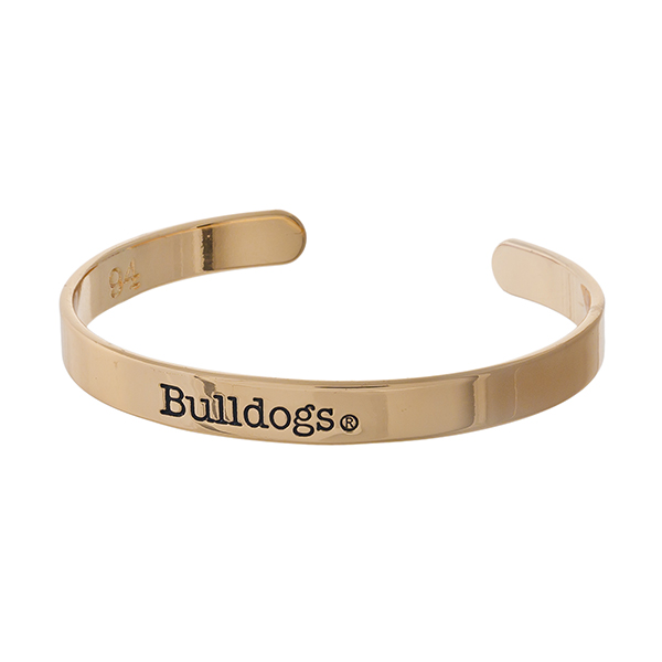"""Officially licensed, University of Georgia gold tone cuff bracelet stamped with """"Bulldogs."""""""