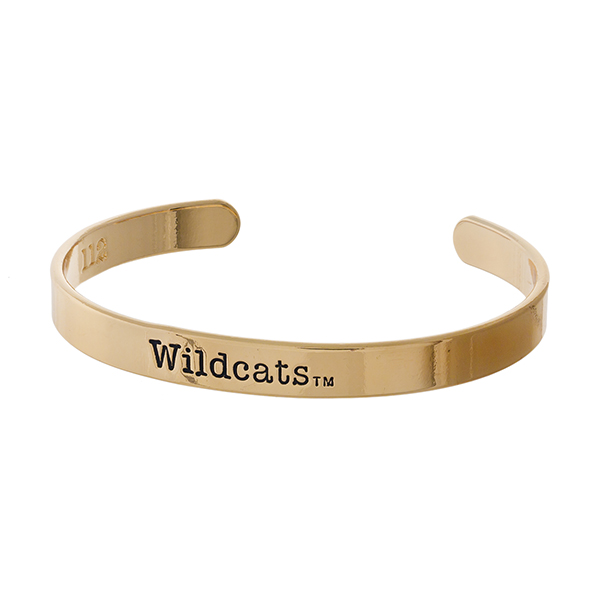 "Officially licensed, University of Kentucky gold tone cuff bracelet stamped with ""Wildcats."""