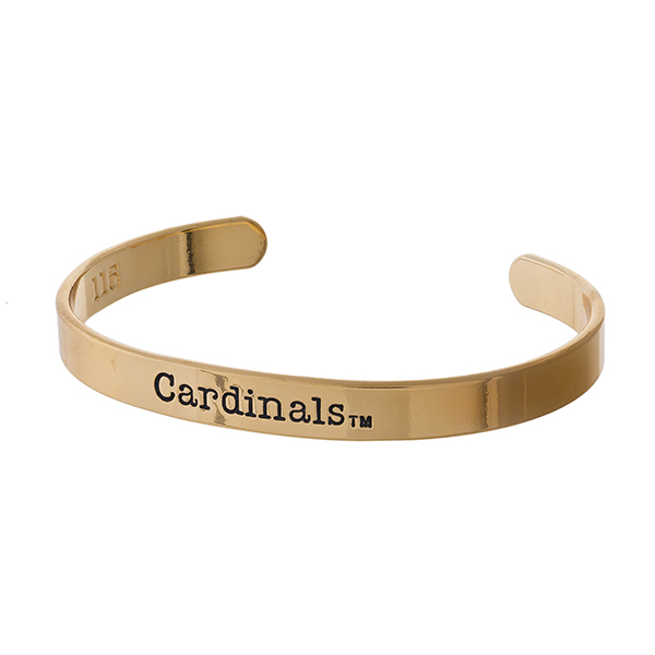 "Officially licensed, University of Louisville gold tone cuff bracelet stamped with ""Cardinals."""