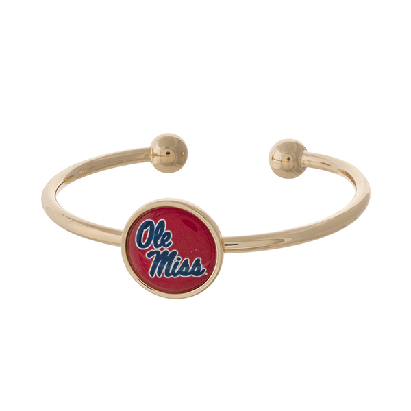 Officially licensed, gold tone cuff bracelet with the Ole Miss logo.