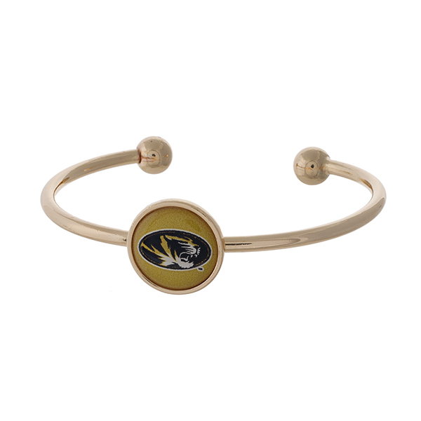 Officially licensed, gold tone cuff bracelet with the University of Missouri logo.