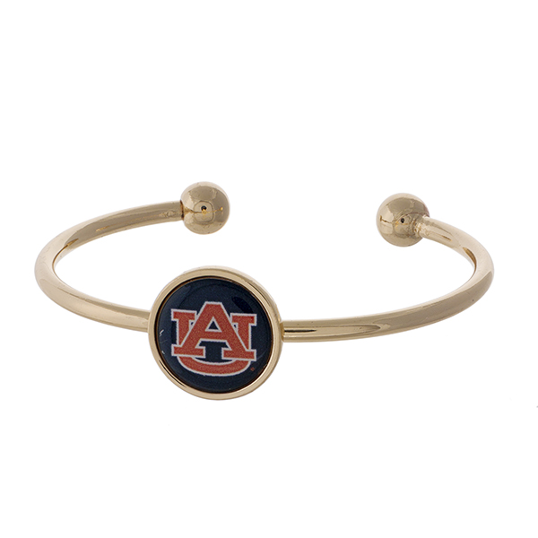 Officially licensed, gold tone cuff bracelet with the Auburn University logo.