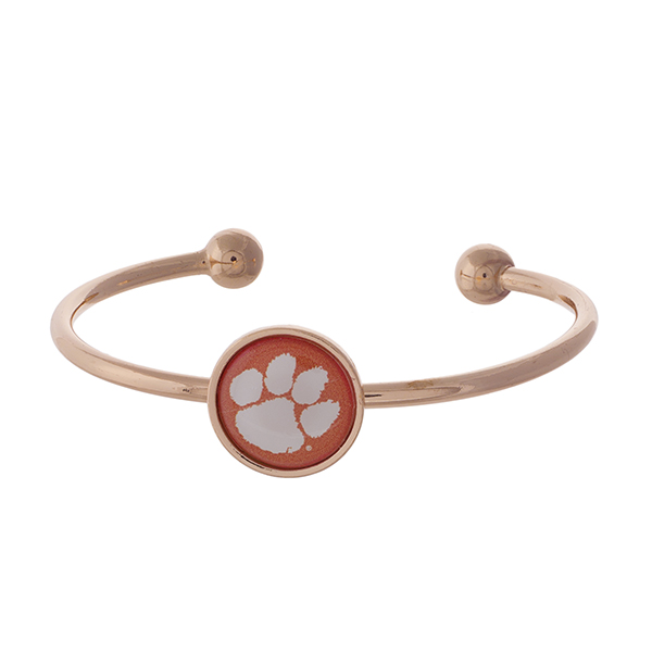 Officially licensed, rose gold tone cuff bracelet with the Clemson University logo.