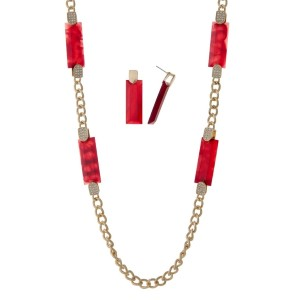 "36"" Gold tone chain necklace featuring rectangular shape marbleized red link accented by crystal clear rhinestones and matching 1 1/2"" post style earrings."