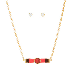"Gold tone necklace set featuring a bar wrapped in brown and coral thread with a coral natural stone focal. Approximately 16"" in length."