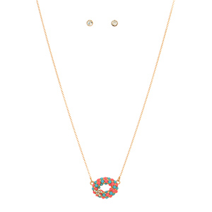"Gold tone necklace set featuring an oval with turquoise and coral epoxy stones and a rhinestone starfish accent. Approximately 16"" in length."