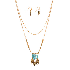 "Burnished gold tone layering necklace set featuring turquoise beaded fringe with hanging leaves. Approximately 18"" in length."