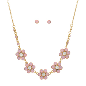 "Gold tone necklace set featuring pink opal floral castings. Approximately 16"" in length."