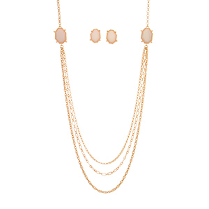"Gold tone necklace set featuring pale pink cabochons with the matching 3/4"" earrings. Approximately 36"" in length."