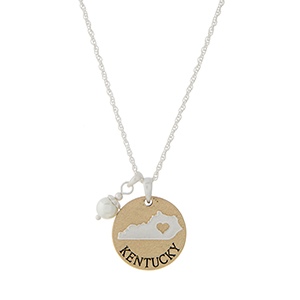 """Two tone state necklace with a """"KENTUCKY"""" disk and a faux ivory pearl accent. Approximately 19"""" in length."""