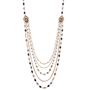 """Gold tone necklace displaying drapes of blue and navy beads with two citrine teardrop shaped cabochons. Approximately 34"""" in length."""
