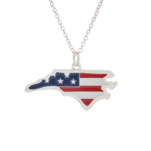 """Silver tone necklace with an American flag inspired state of North Carolina pendant. Approximately 18"""" in length."""